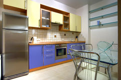 Kitchen with the built in home appliances royalty free stock photos