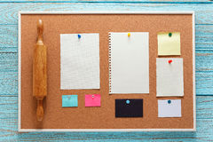 Kitchen bulletin board with note paper Stock Images