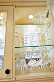 Kitchen cabinet. Close up with glass shelves and glasses stock photos