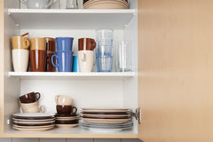 Kitchen cabinet or cupboard for dishes royalty free stock photography