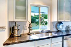 Kitchen cabinet with granite top and sink Royalty Free Stock Images