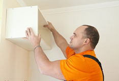 Kitchen cabinet installation work Stock Photo
