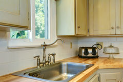 Kitchen cabinet with sink. View of faucet Royalty Free Stock Photos