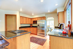 Kitchen cabinets with black granite top. Stock Photos