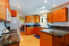 Kitchen cabinets with black granite tops Stock Images