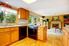 Kitchen cabinets with black stove and washdisher Stock Images