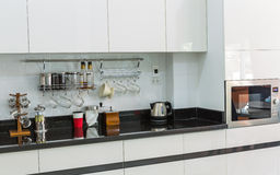 Kitchen cabinets with coffee corner in modern home living room. Royalty Free Stock Photography