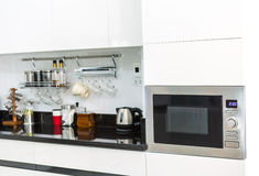 Kitchen cabinets with coffee corner in modern home living room. Stock Images