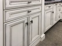 Kitchen cabinets finished in white paint with granite counter. stock image