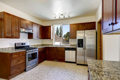 Kitchen cabinets with granite tops and ss-appliances Royalty Free Stock Photos