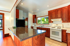 Kitchen cabinets with granite tops and white appliances Stock Image