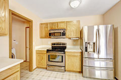 Kitchen cabinets with steel appliances Royalty Free Stock Photo