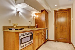 Kitchen cabinets with steel microwave. Stock Image