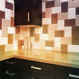 Kitchen cabinets and tiled backsplash in warm colors. Modern kitchen cabinets and tiled backsplash in warm colors royalty free stock images