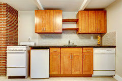 Kitchen cabinets with white appliances Royalty Free Stock Image
