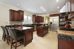 Kitchen with cherry wood cabinetry Stock Image