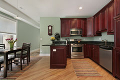 Kitchen with cherry wood cabinetry Stock Photos