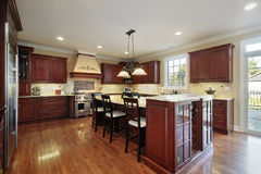 Kitchen with cherry wood cabinetry Royalty Free Stock Photography