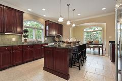 Kitchen with cherry wood cabinetry Royalty Free Stock Photos
