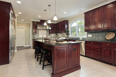 Kitchen with cherry wood cabinetry Royalty Free Stock Image