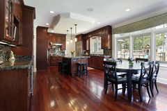 Kitchen with cherry wood cabinetry Stock Photo