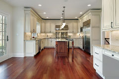 Kitchen with cherry wood floor Royalty Free Stock Photos