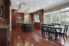 Kitchen with cherry wood flooring Royalty Free Stock Images