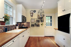 Kitchen with cherry wood floors Stock Photo