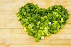 The kitchen chopping board, placed with shallot pe. Ndulum heart,the color is very beautiful, the picture is very warm Stock Images