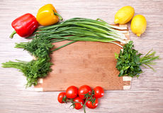 Kitchen chopping board with vegetables Stock Images