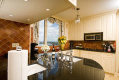 Kitchen in city apartment with skyline views Royalty Free Stock Photo