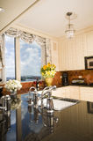 Kitchen in city apartment with skyline views Stock Photos