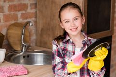 Kitchen clean up washing dishes girl wiping plate stock photo