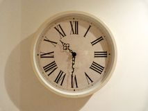 Kitchen clock. Cream vintage kitchen clock at bedtime Royalty Free Stock Images