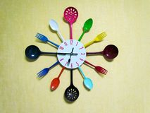 Kitchen clock made with plastic tableware royalty free stock photos