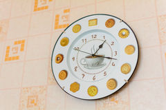 Kitchen clock with a picture of a Cup of coffee. Round clock hanging on the wall in the room stock illustration