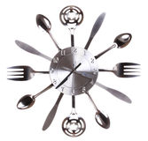 Kitchen clock with spoons and forks. Concept. Time passes in kitchen Stock Images