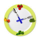 Kitchen clock with vegetables. Isolated on white background Stock Photo