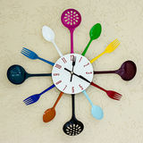 Kitchen clock witch spoon and fork. Stock Image