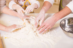 Kitchen. Close-up hands of family are baking cakes in home kitchen stock images