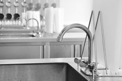 Kitchen closeup. Closeup of kitchen tap in a big kitchen Royalty Free Stock Photography