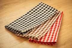 Kitchen cloth on wood table. With copy space - Vintage Filter Royalty Free Stock Images