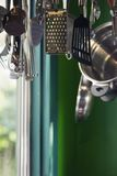 Kitchen clutter 01. Instruments of torture hanging on the rack Royalty Free Stock Photos