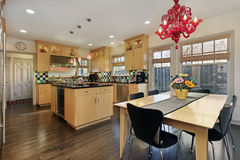 Kitchen with colored tile backsplash. Kitchen with oak cabinetry and colored tile backsplash royalty free stock image