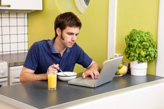 Kitchen Computer Work Royalty Free Stock Photography