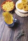 Kitchen containers with pasta ready to cook. Royalty Free Stock Image