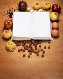 Kitchen. Cooking book and food Stock Photos