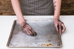 Kitchen cooking fail dirty hands clean baking pan. No dinner today. Kitchen cooking fail. Woman hands cleaning dirty baking pan royalty free stock photo