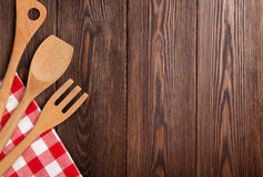 Kitchen cooking utensils over wooden table Stock Images