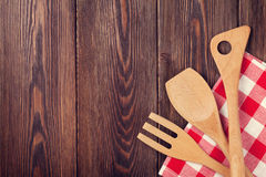 Kitchen cooking utensils over wooden table. Background. Top view with copy space. Retro toned Stock Photos